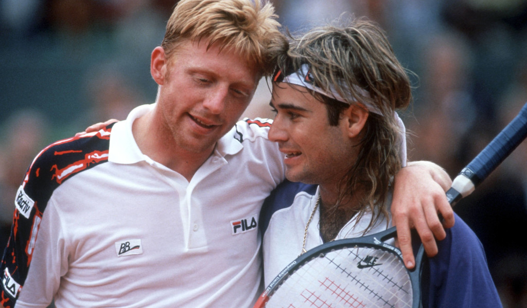 Boris Becker and Andre Agassi hugging