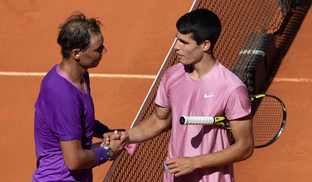 Rafael Nadal and Carlos Alcaraz shaking hands