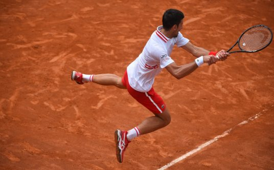 Novak Djokovic in the air