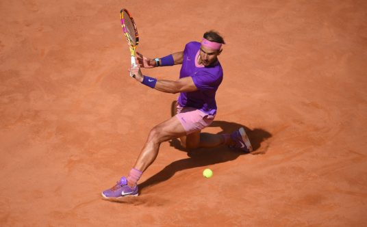 Rafael Nadal sliding on the clay