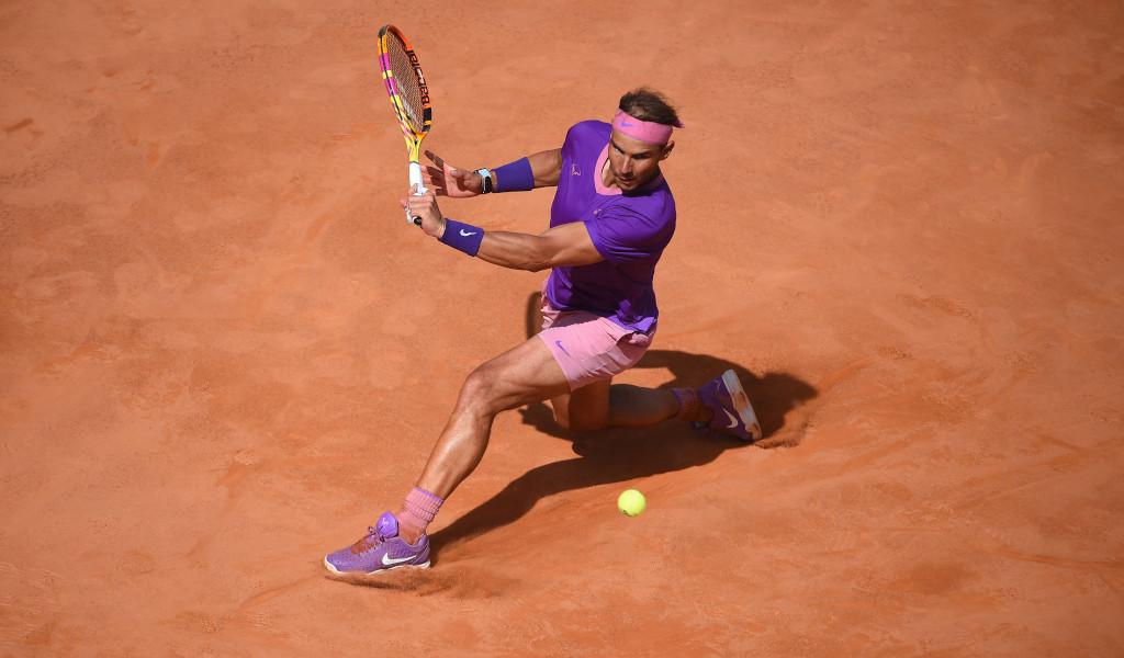 Rafael Nadal sliding on the clay