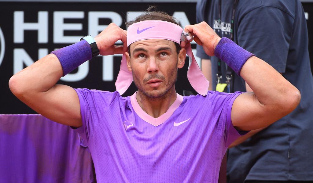 Rafael Nadal fixing his headband
