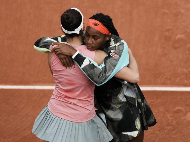 Coco Gauff, right, hugs Jennifer Brady following the latter's retirement