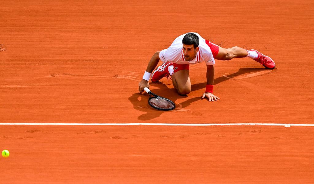 Novak Djokovic hits the deck