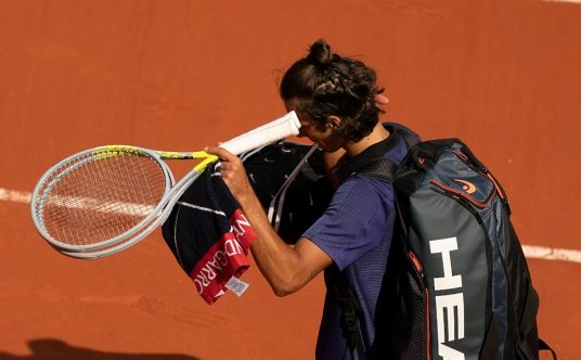Lorenzo Musetti leaves the court