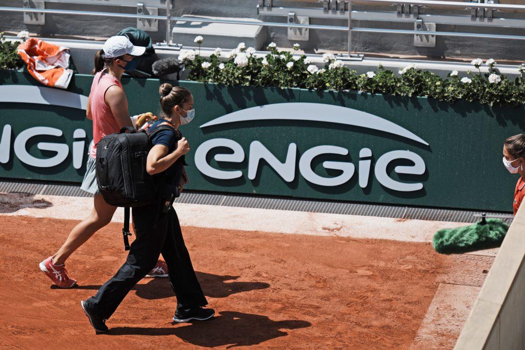 Iga Swiatek leaves the court
