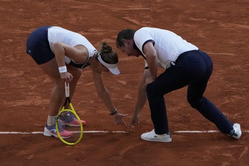 Barbora Krejcikova and chair umpire check a mark