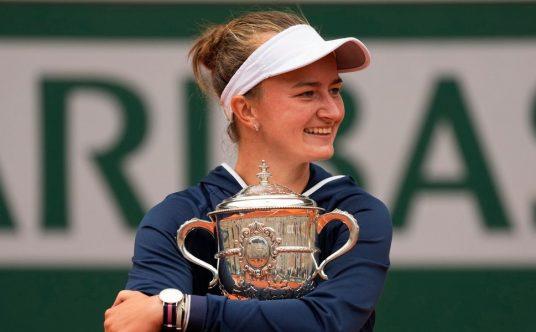 Barbora Krejcikova hugs French Open trophy