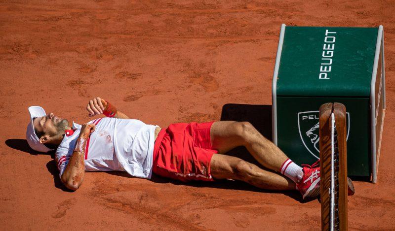Novak Djokovic takes a tumble