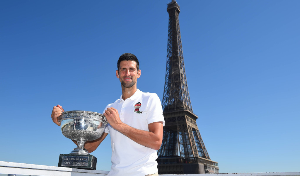 Novak Djokovic with French Open trophy at Eiffel Tower