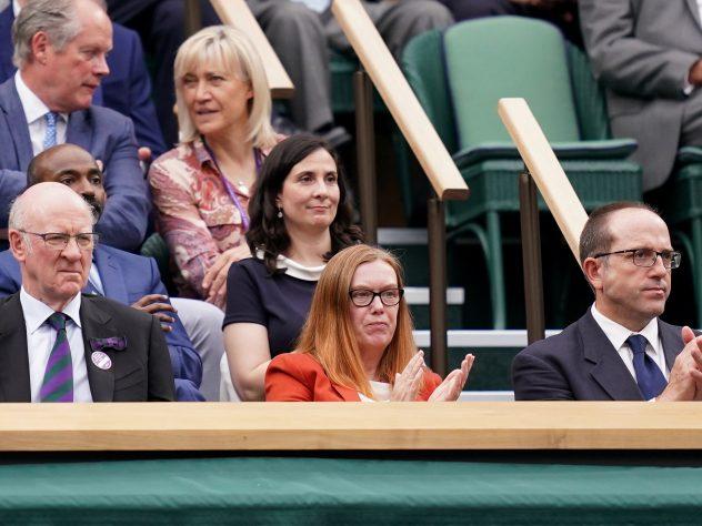 Dame Sarah Gilbert (centre) applauds in the Royal Box