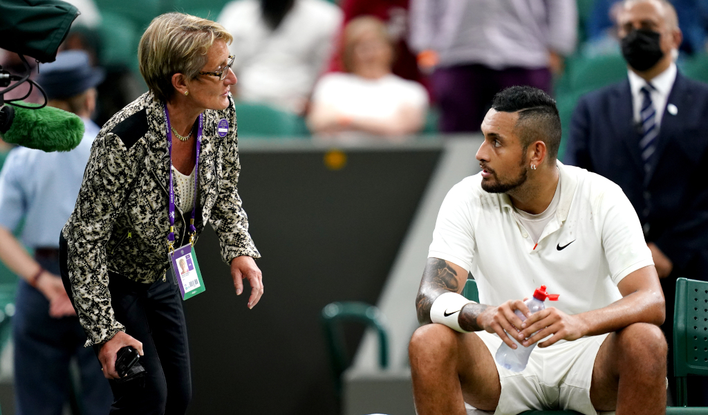Nick Kyrgios speaks to Wimbledon official