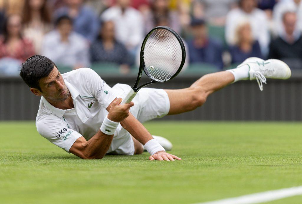 Novak Djokovic slipping on Wimbledon Centre Court