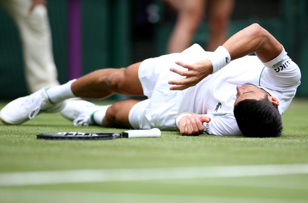 Novak Djokovic slips at Wimbledon