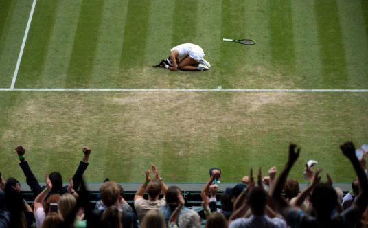 Emma Raducanu celebrates at Wimbledon