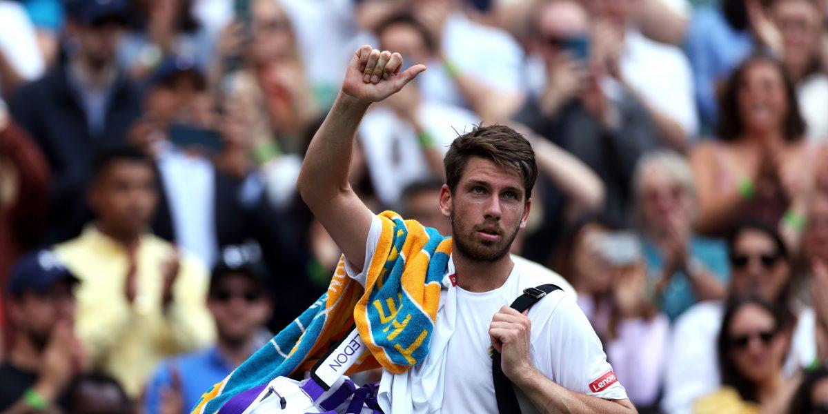 Cameron Norrie waves goodbye