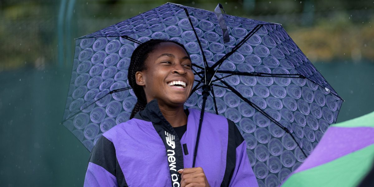 A laughing Coco Gauff