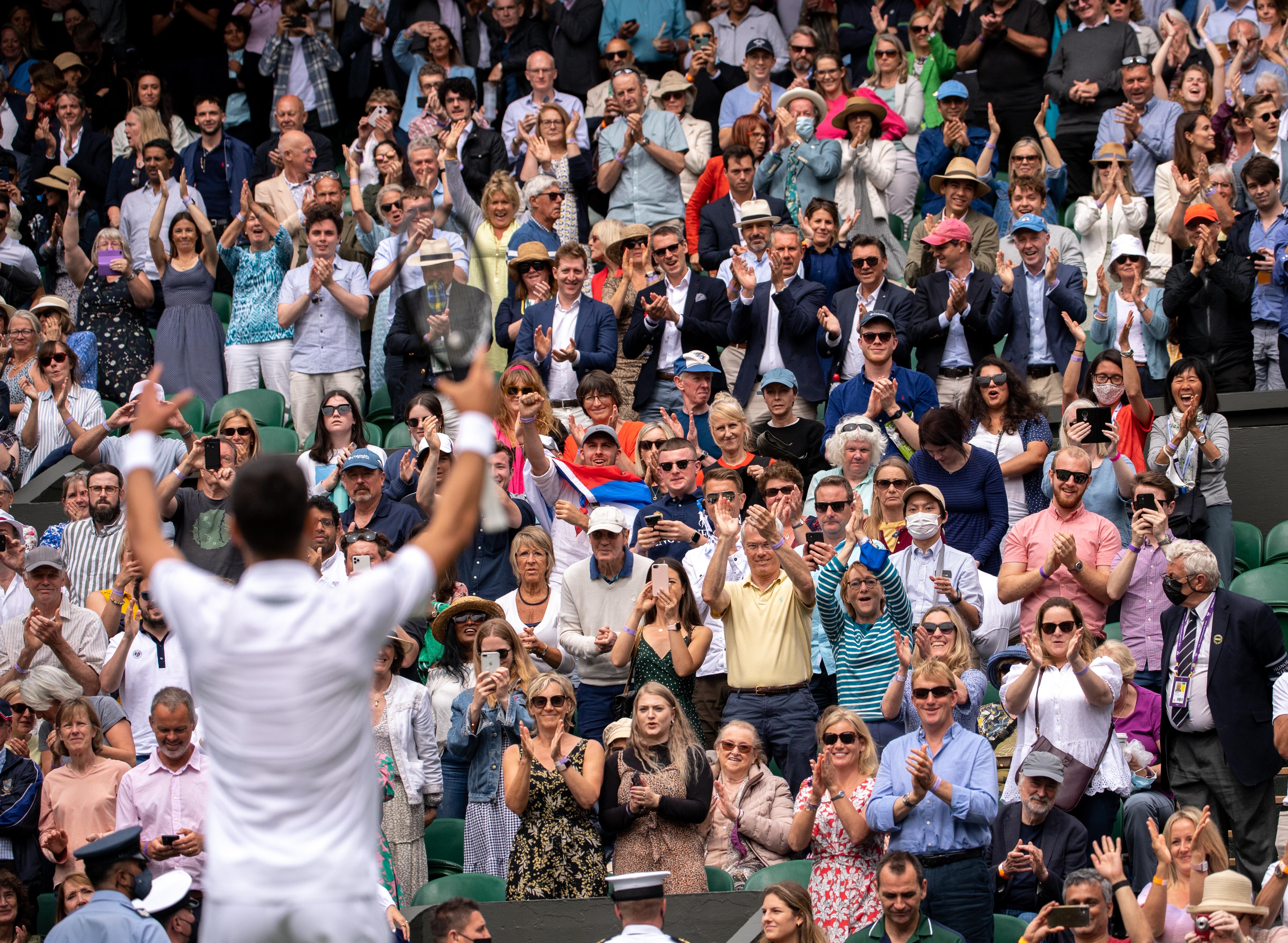 Novak Djokovic celebrates with fans