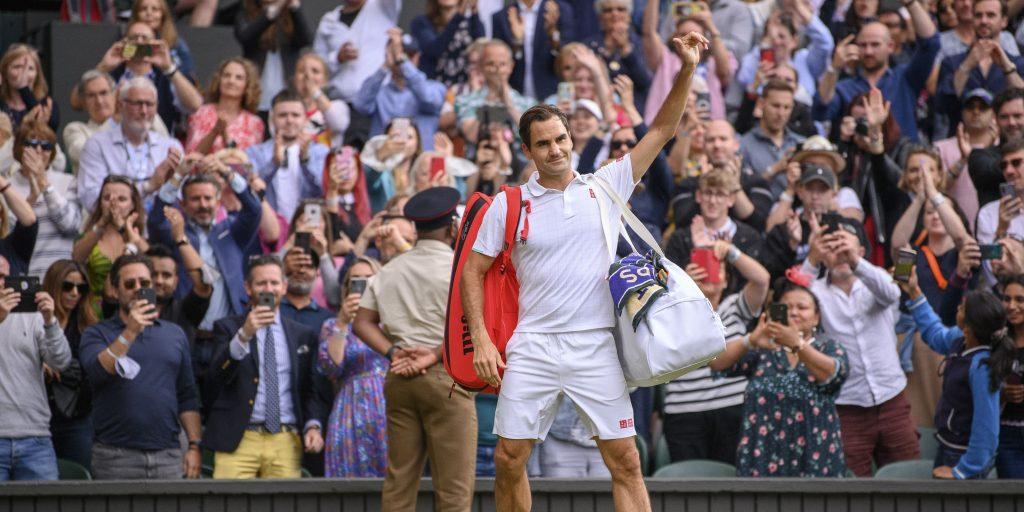 Roger Federer waves goodbye