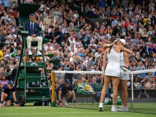 Ashleigh Barty (right) hugs Ajla Tomljanovic on Centre Court