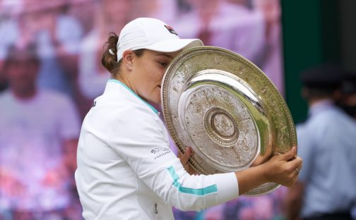 Ashleigh Barty has a closer look at the Wimbledon trophy