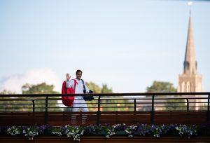 Roger Federer waves to fans