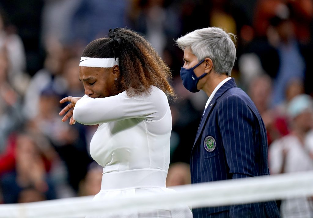 An injured Serena Williams leaves the court
