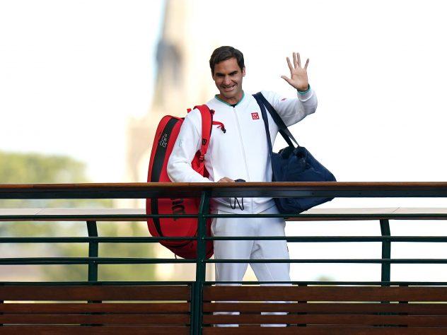 Roger Federer waves at Wimbledon