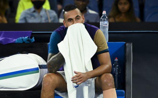 Nick Kyrgios with a towel