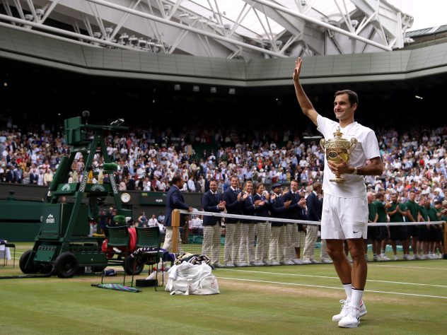Roger Federer celebrates with the trophy at Wimbledon