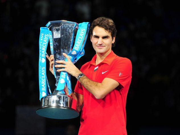 Roger Federer with the ATP Finals trophy