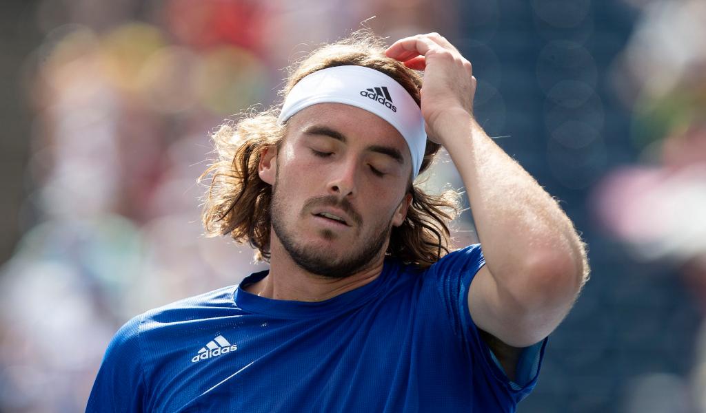 Stefanos Tsitsipas reacts during a tennis match
