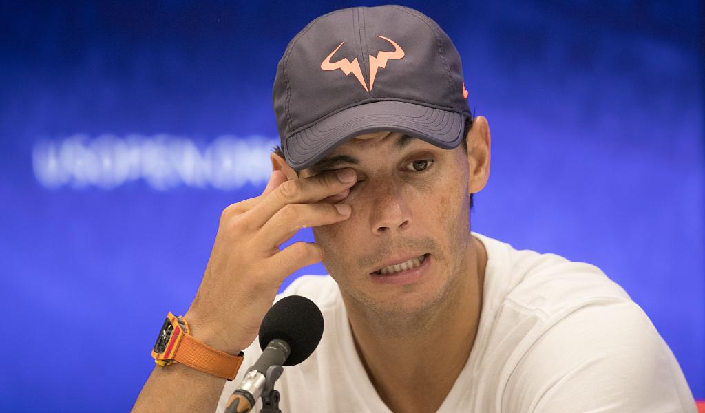 Rafael Nadal talks to the press