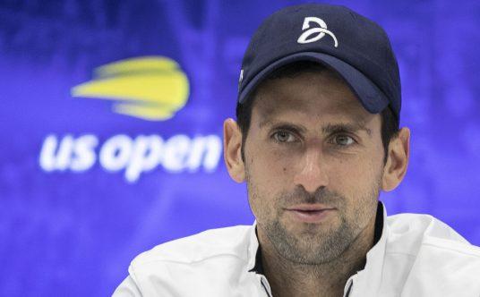 Novak Djokovic talks to the media
