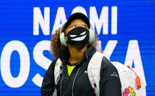 Naomi Osaka arrives on the court
