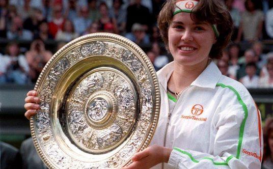 Martina Hingis lifts Wimbledon trophy