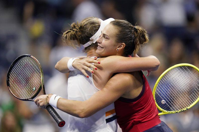 Barbora Krejicova and Aryna Sabalenka embrace