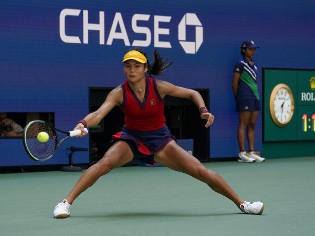 Emma Raducanu returns a shot to Belinda Bencic
