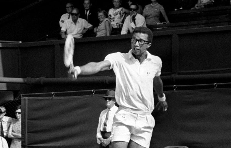 Arthur Ashe in action