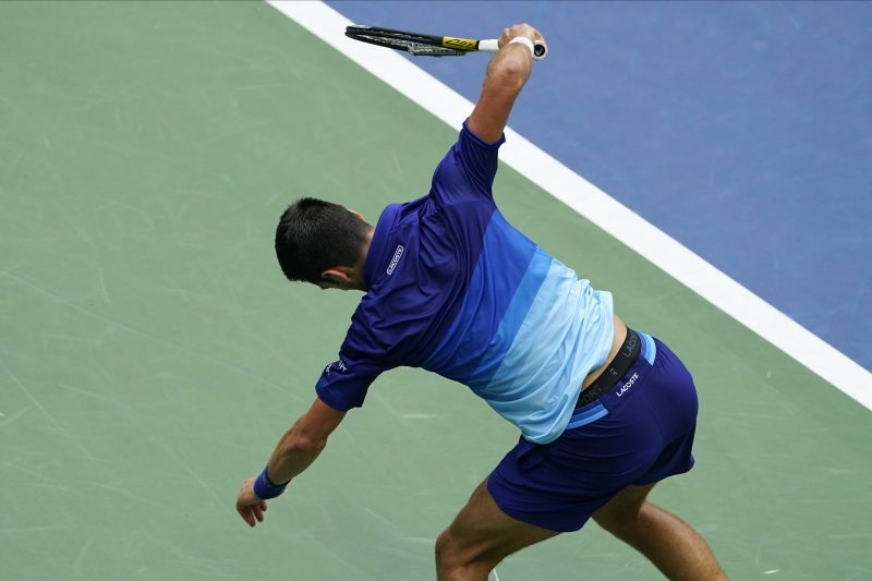 A frustrated Novak Djokovic cracks his racket