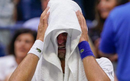 Novak Djokovic gets emotional under his towel
