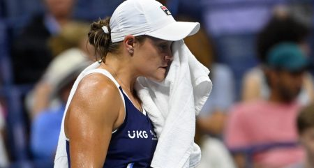 Ashleigh Barty wipes her face