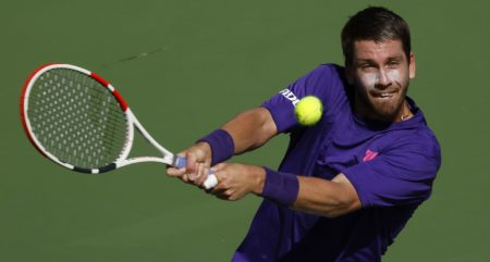 Cameron Norrie plays a shot