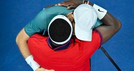 Andy Murray and Frances Tiafoe embrace